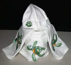Turtle Hat, bib, burp cloth and Blanket. Anything  and everything you want embroidered. Good prices, and we ship everywhere!! Contact: eloisa@embroiderbyme.com