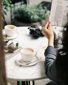 Favorite places and spaces | latte, coffee, breakfast, reading the newspaper, camera, marble table, bistro table, morning routine