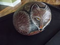 Painted rock of a red fox hand painted by my dad, Randall Wimer, look him up on Etsy to see more amazing art!
