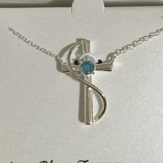 Selling this Genuine Blue Topaz Sterling Silver Cross Necklace in my Poshmark closet! My username is: mtnoonan. #shopmycloset #poshmark #fashion #shopping #style #forsale #Jewelry