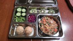 Fried rice, kiwi, cucumbers, raw peas, pomegranate seeds, peanut butter balls
