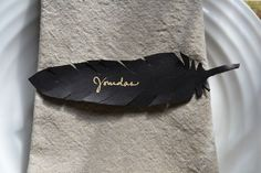 Black paper feather placecards