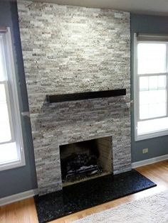 Most current Images Fireplace Hearth black Style A contemporary fireplace in El Capitan Gray Blend. The black granite hearth really makes the gray t Fireplace Hearth Stone, Granite Fireplace, Fireplace Tv Wall, Build A Fireplace, Fireplace Remodel, Modern Fireplace, Fireplace Surrounds, Fireplace Design, Rustic Fireplaces