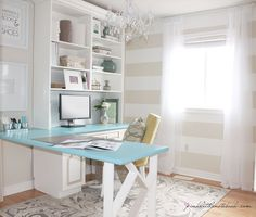 Office idea: bookcase with a table that folds up against the wall to save space.