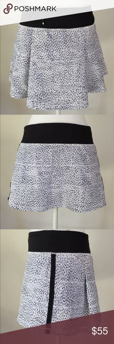 Lululemon Athletica B&W Tennis Skort, S This super cute Lululemon Athletica B&W Tennis Skort, S is great for those indoor or outdoor tennis sessions at the gym. EXCELLENT CONDITION, NO DEFECTS AND COMES FROM A SMOKE FREE HOME. lululemon athletica Shorts Skorts