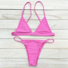 A standard solid bikini should be a staple of every girl's swimsuit collection. Whether you are at the pool, the beach, or even a barbecue, these swimsuits always look good. Shipping Note: Please be a