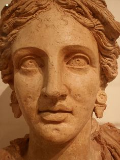 Bust of Kore (Persephone) wearing a cloak and circlet. Terracotta. End of the 4th/first half of the 3rd c. BCE Votive deposit of the sanctuary of Demeter and Kore at loc. Casaletto, Ariccia.  Museo Nazionale Romano: Terme di Diocleziano Rome, Italy