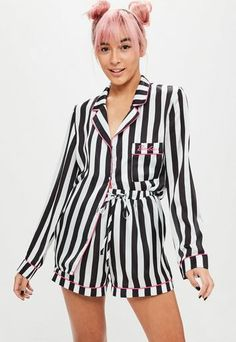 These pyjamas come in a striped black and white finish, satin fabric and barbie logo.