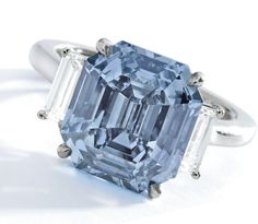 EXQUISITE FANCY VIVID BLUE DIAMOND AND DIAMOND RING. Set with an emerald-cut Fancy Vivid Blue diamond weighing 5.69 carats, flanked by baguette diamonds, size 5¼. Estimate 12,000,000 - 15,000,000 USD // LOT SOLD 15,130,800 USD. GIA / the diamond is Fancy Vivid Blue, Natural Color, VVS1 clarity. Together with the original working diagram stating that the diamond may be potentially Internally Flawless [S. NY - MAGNIFICENT JEWELS - 05 DEC. 2017] #Sothebys #FancyVividBlue #Diamond