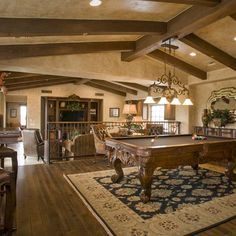 Billiards room open to Family Room, with steps up to game area; nice feature. -db |