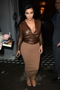 Kim Kardashian Supports Bruce Jenner 'No Matter What'. Kim Kardashian shows some cleavage in a sexy brown ensemble while stepping out after dinner at Craig's on Monday (January in Los Angeles. Kim Kardashian Show, Kardashian Style, Kardashian Jenner, Kardashian Family, Kim K Style, Love Her Style, Style 2014, Brown Skirts, Models