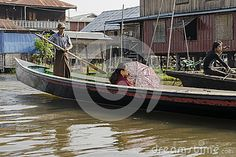 Exotic Floating village at Inle Lake, Myanmar and people on the boats.