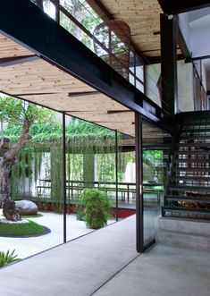 New Book on Bali Sustainable Design | Architectural a walkway with a bamboo ceiling surrounds a Japanese-inspired garden.