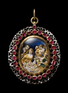 The Birth of Jesus, mid 17th century, gold, silver, enamel, glass, ruby, Gold and silver oval locket, the front with an outer border of black and white openwork ornament surrounding a line of rubies enclosing a glass covered cut-out gold enamelled scene of the Nativity, with two angels in the stable adoring the infant Jesus watched by his mother, the Virgin Mary and by St. Joseph set against a blue foil ground.
