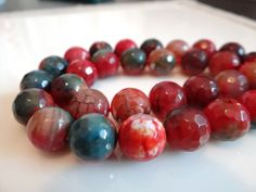 1/2 STRANDApatite Blue and Red Agate Faceted Round by norah62, $24.99