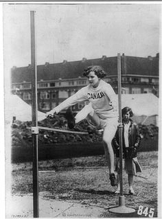 """Miss Catherwood of Canada doing the high jump in the Olympic Games at…"