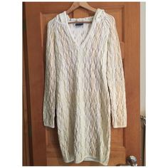 "Multi color COOGI Australia dress size S Multi color COOGI Australia dress size S. Color are beige, brown, white and a very light green. Has a stain ""see picture"". Used a few times. COOGI Dresses"