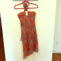New Gorgeous BCBG Maxazria tie dress. Size 8!!! Beautiful BCBG Mazazria assymterical dress strapless/halter neck tie. Soft chiffon material silk inner lining. Beautiful bold print in summery hues. Size 8 (roomy in dress/skirt part can even fit a 10 but smaller on bust) perfect for someone with a small bust. I'm  sad to part with this one!! The pictures don't begin to do it any justice it's the perfect summer piece. This is new! Too late to return so I'm selling at a steal price for what I…