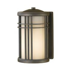 Prairie-style outdoor wall lantern in oil rubbed bronze with opal etched glass.    Product: Wall lanternConstruction Material: AluminumColor: Oil rubbed bronzeFeatures: White opal etched glass shade UL listed for wet locations      Accommodates: (1) 100 Watt medium base bulb - not included