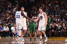 Klay Thompson and Draymond Green of the Golden State Warriors high five each other during the game against the Boston Celtics on March 8 2017 at...