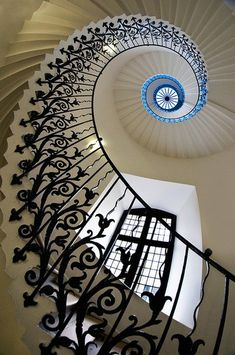 gorgeous unique staircase - absolutely adore the transition to blue and the huge windows