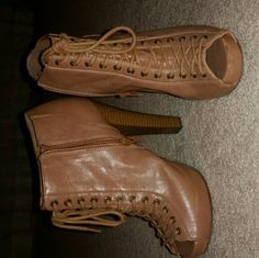 Brown lace up booties Extremely comfortable brown lace up express boots. A little too small for me as I am a 10. Have only worn a handful of times. Great condition, still look brand new! Express Shoes Ankle Boots & Booties