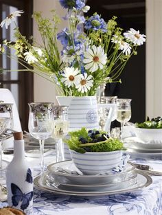 Pretty striped dishes, wildflowers, blue and white linens for a pretty spring or summer table...