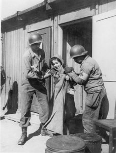 Penig, Germany, 1945 - American medics helping a young survivor at the Penig Concentration Camp (a sub camp of Buchenwald).