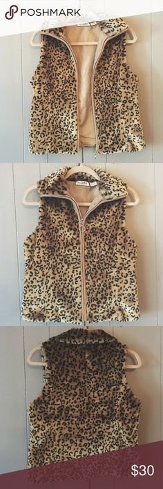 Like New Vegan Fur Leopard Vest✨ This super cool vest is very well made! It is in like new condition with no signs of wear at all! Fabric breakdown in last picture. Please don't hesitate to ask for more specific measurements. Thanks! :) Tiara International  Jackets & Coats Vests