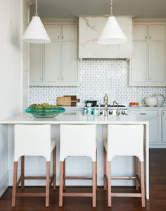 Coastal Modern Kitchen In Sleek Cream Cabinets With Soft Hits Of Teal //  This Gorgeous Atlanta, Georgia Condo By Interior Designer Andrew J. Howard  Fits A ...