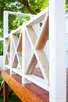 The X railing is perfect for the cottage style playhouse. See how we are building the DIY playhouse railing including build plans and time/cost breakdown. Outside Playhouse, Backyard Playhouse, Build A Playhouse, Pallet Playhouse, Pallet Patio, Front Porch Railings, Deck Railings, Porch Railing Plans, How To Build Porch Railing