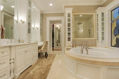 Memorial Hamptons Style traditional bathroom - YUCK is that CARPET under the vanity??? LOVE the vanity layout though.