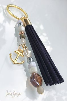 Key chain / bag charms in gold, with blue tassel, beads & anchor charm… Tassel Jewelry, Jewelry Box, Jewellery Diy, Key Bag, Anchor Charm, Diy Jewelry Inspiration, Wooden Beads, Jewelry Trends, Gold