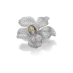 Diamond ring, 'Caresse d'orchidées', Cartier Designed as an orchid pavé-set with diamonds of pink, yellow and near colourless tints- GOLDEN GLOBES 2005