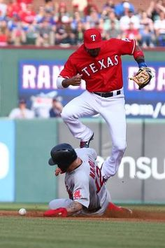 ARLINGTON, TX - MAY 30: Mike Napoli #12 of the Boston Red Sox slides safely into second base after a dropped ball by Elvis Andrus #1 of the Texas Rangers during a game at Globe Life Park in Arlington on May 30, 2015 in Arlington, Texas. (Photo by Sarah Crabill/Getty Images)