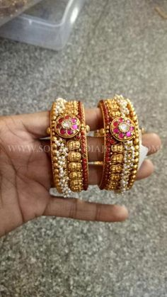 Antique Pearl Ruby Bangle gold antique bangle studded with rubies and embellished with pearl clusters. For inquiries please contact the seller below. Seller Name : Rohit Jewellers Contact : 098497 95735 Related PostsGold Oxidized Bangles With PearlsBig The Bangles, Ruby Bangles, Bracelets Design, Gold Bangles Design, Jewelry Design, India Jewelry, Fine Jewelry, Gold Jewellery, Jewelry Rings