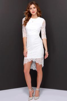 """She looks like an angel, and walks like an angel, but in the Angel Eyes White Lace Dress, you just never know! This sultry little white dress has an enticing bodycon fit covered in beautiful floral lace. A round-neck bodice includes sheer half sleeves trimmed in eyelash lace, with a matching peekaboo high-low hem. Hidden back zipper/hook clasp. Lined to mid-thigh. Dress measures 7"""" longer at back. Self: 100% Nylon. Lining: 100% Polyester. Hand Wash Cold. Imported."""