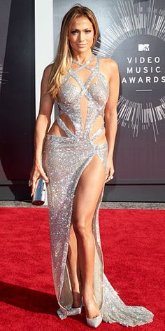 JENNIFER LOPEZ Did we just get in a time machine and travel back to 2001? Because Jenny from the Block is back in her sparkly, complicatedly cut-out gunmetal gown, featuring a crazy-high slit.