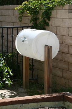 Homemade compost bin my father made for me out of a 30 gallon plastic drum.  (Recycled from a local car wash - it was a soap drum). papacarazzi