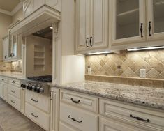 cabinet color not sure about the hardware neutral backsplash detail around cooktop recessed areas by cooktop would they collect dirtgrease
