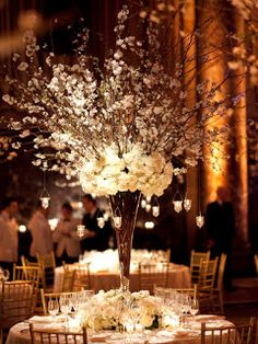 Tall, white floral hanging candle centrepieces