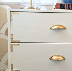 DIY Campaign Style Nightstands -- using 2 in. satin brass flat corner braces (4 pack) from Home Depot ($2.47 ea) http://www.homedepot.com/p/Unbranded-2-in-Satin-Brass-Flat-Corner-Braces-4-Pack-15071/202034207 // spray paint to match color of drawer pulls