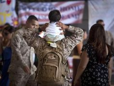 U.S. Marine Sgt. Stephan Ramirez, an automotive organizational mechanic with Combat Logistics Battalion 3, carries his son on his shoulders shortly after returning to Marine Corps Base Hawaii from a seven-month deployment to Afghanistan, Aug. 21, 2012. Approximately 110 Marines with the advanced parties of Marine Heavy Helicopter Squadron 362, CLB-3 and a 3rd Marine Regiment Embedded Training Team also returned from their seven-month deployments. (DVIDS photo by Cpl. Reece Lodder.)