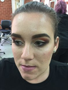 A night make up look, I created using warm reds