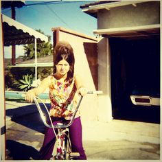 Vintage Photo 1960s Girl With Ratted Bouffant Hair On Bike, via Flickr.