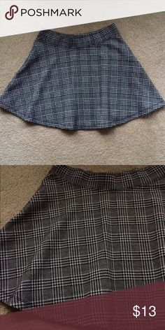 """Plaid Skirt Adorable & flowy plaid skirt. White, gray, and black. Waist is elastic and measures out to be 28"""". Therefore the size of this skirt is an 8. Length is 15 and a half inches Forever 21 Skirts"""