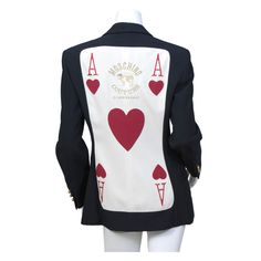 'Ace of Hearts' jacket | Franco Moschino (Italian, 1950-1994) | Italy, 1980's | The back is appliqued and embroidered with the Ace of Hearts from a deck of cards. It is also embroidered in gold metallic thread with the Moschino Couture logo