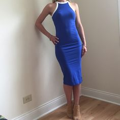 Blue Sleeveless Midi Dress Blue midi dress with white trim at the top. Length 42in Bust 13in Dresses Midi
