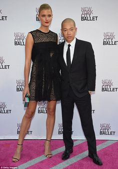 Designs on you: The leggy model posed for pictures with designer Jason Wu...