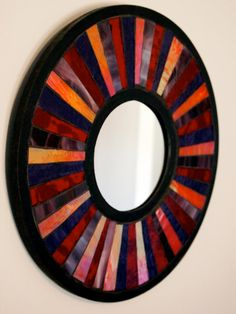 mosaic mirror in reds and purples by IndiVisualCreations on Etsy,